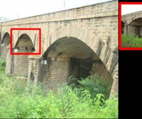 Performance Evaluation of Stone Masonry Arch Railway Bridge Under Increased Axle Loads