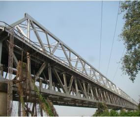 Performance evaluation and retrofitting of open web girder type of steel truss rail cum road bridge